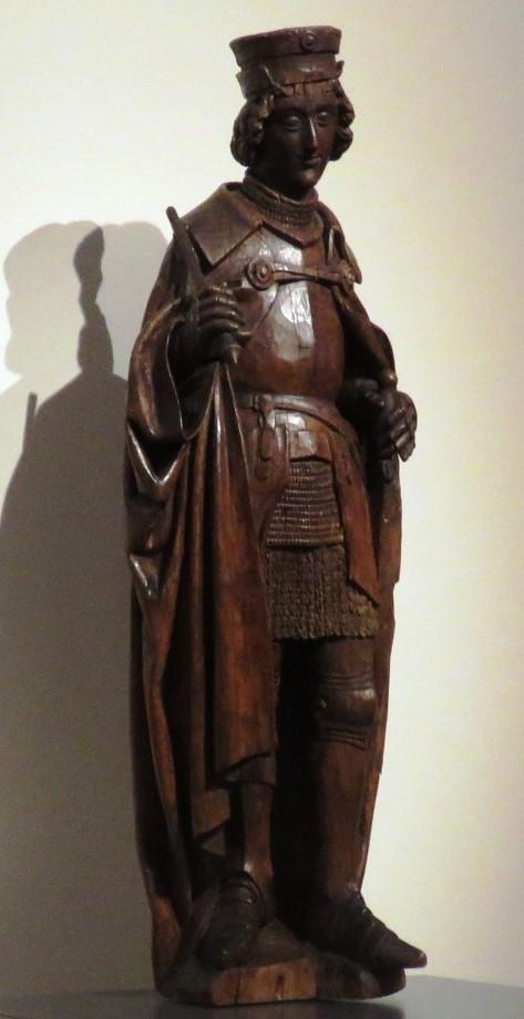 En la sala 3, se expone una escultura anónima de San Adrián (1501-1525), un santo vinculado a localidades del norte de Francia y la región de Gante. Oficial del ejército de Maximiliano, entre sus atributos están la espada, la llave -que alude a los carceleros de quienes es patrón-, y la indumentaria de guerrero